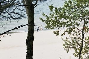 Fußgänger am Strand von Pobierowo